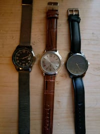 two round silver analog watches with black leather straps Thunder Bay, P7B 3Z8