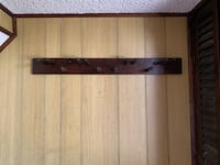 Wall-mounted coat and hat rack. Holds 12. Manalapan, 07726