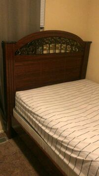 brown wooden bed frame and white mattress 56 km