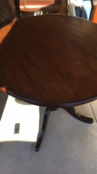 round brown wooden pedestal table 392 mi