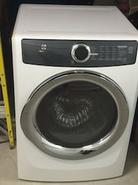 white and black Samsung front-load clothes washer La Joya, 78560