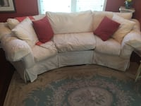 Rowe white fabric curved sofa with throw pillows Matthews