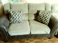gray leather and white fabric padded loveseat Kissimmee, 34759