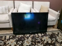 black flat screen TV with remote Calgary