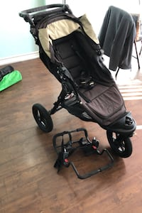 Stroller with attachment for a baby car seat