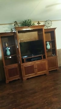 brown wooden TV hutch with flat screen television Stonewall, 71078