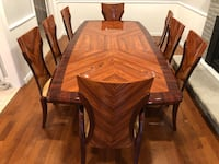 Like new dining table and 8 chairs 519 km