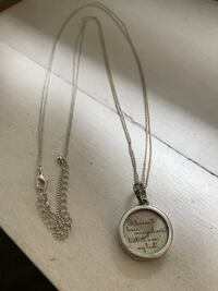 Travel-themed silver necklace