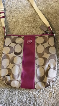 Brown and pink coach monogram crossbody bag