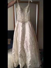 Brand New Wedding Gown. Size 10. No alterations made. Never worn Smoke Minneapolis