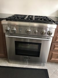 5 year old stainless steel Thermador stove and brand new hood and fan  Vaughan, L4H 4C5