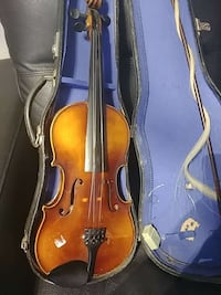 brown violin with bow and case for kid's