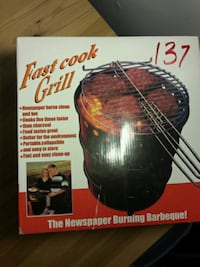 Newspaper burning grill.  New in box Chantilly, 20151