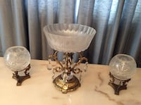 Two candle holders and center