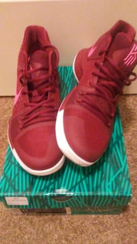 pair of red and white Kyrie Irving basketball shoes on box Canal Winchester, 43110