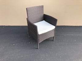 Patio wicker chair with cushion
