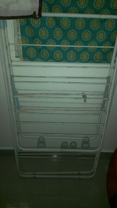 white steel clothes drying rack