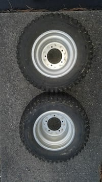 two gray vehicle wheel with tires