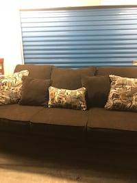 brown fabric 3-seat sofa with throw pillows Chesapeake