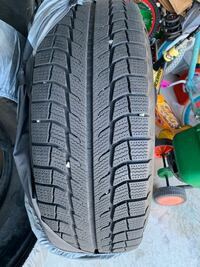 Michelin 245 65 17 winter tires and rims.Only 2000km on the tires  Markham, L6B 0G5