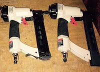 two black-and-white nail guns