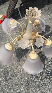 gold-colored and white uplight chandelier Toronto, M1E