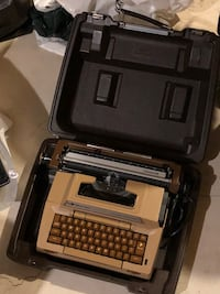 white and brown typewriter with case
