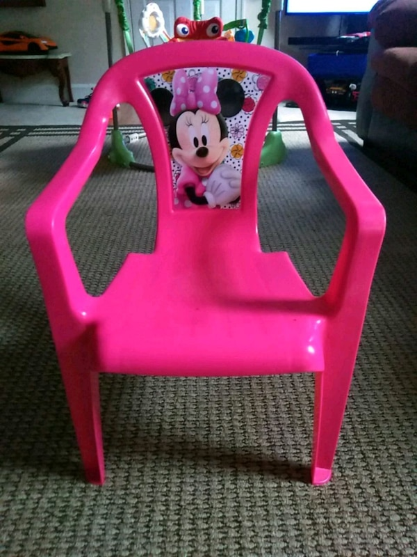 pink and yellow plastic chair