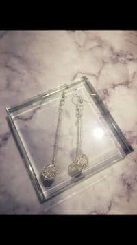 Silver and diamond studded pendant necklace
