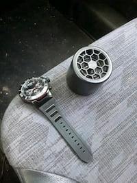 A watch and a Bluetooth speaker
