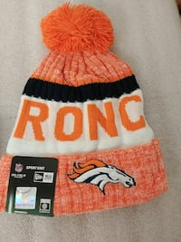 orange and white knitted bobble knit cap