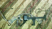black and brown compound bow 212 mi