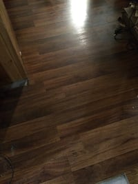 Laminate flooring Aprox 200 still in place on floor need gone ASAP