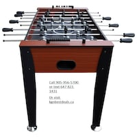 brown and black foosball table Mississauga, ON L4T 3Y9, Canada