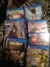 four Sony PS4 game cases Calgary, T3C 0E5