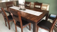 Table and 6 chairs set leather seat covers. Leaf. Gently used great condition  497 km