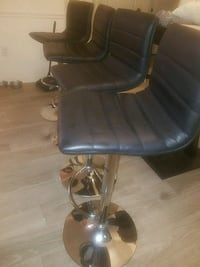 3 leather bar stool chairs  Fort Myers, 33912