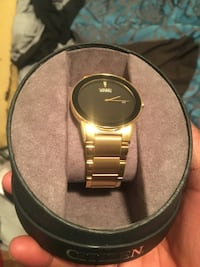 round gold-colored analog watch with link bracelet Edmonton, T5E 5Y6
