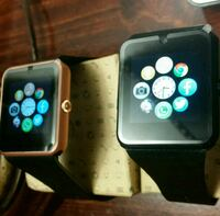 new two black and gold smartwatches Bronx, 10453