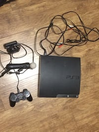 black Sony PS3 slim console with controllers Niagara Falls, L2G 4Z8