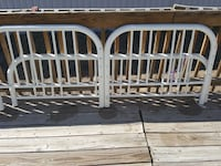 two white convertible metal bed frame