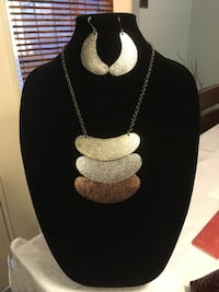 silver-colored necklace with earrings
