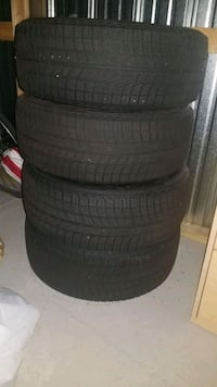 four black vehicle tires with wheels 929 mi