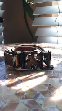 black leather belt with silver-colored buckle 788 km