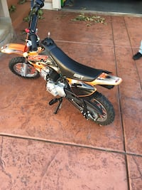 orange and black pocket bike