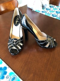pair of black leather peep-toe heels Portland, 97206