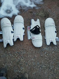 two pairs of white cricket shin guards Calgary, T2A 0S7