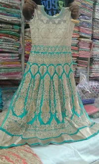 teal and white floral sleeveless dress London, N6M 0B5