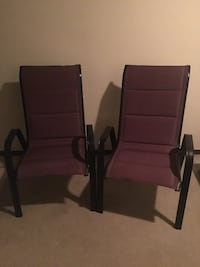 two brown wooden framed black leather padded armchairs Peoria, 61615