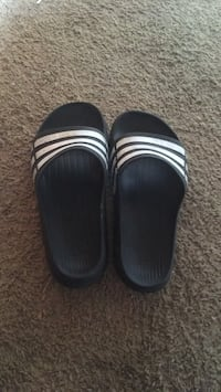 pair of black-and-white slide sandals West Sacramento, 95691